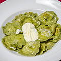 Home-made green ravioli with three cheeses