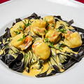 Black tagliatelle with scallops, saffron-flavoured cream
